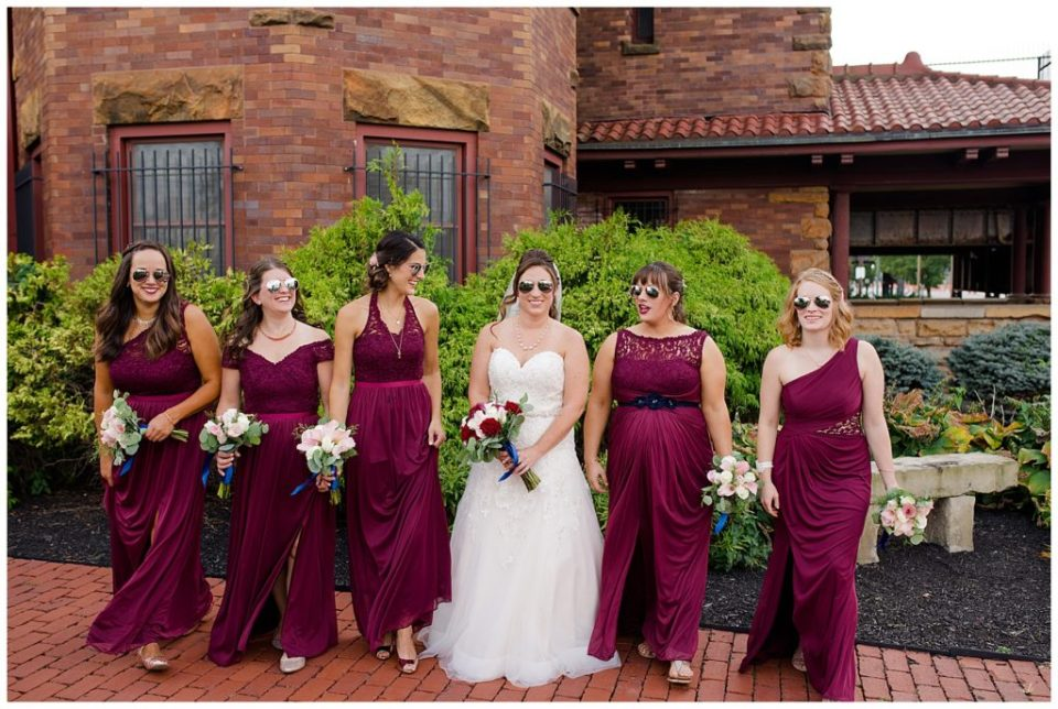 bride and bridesmaids walking with sunglasses on at station 67