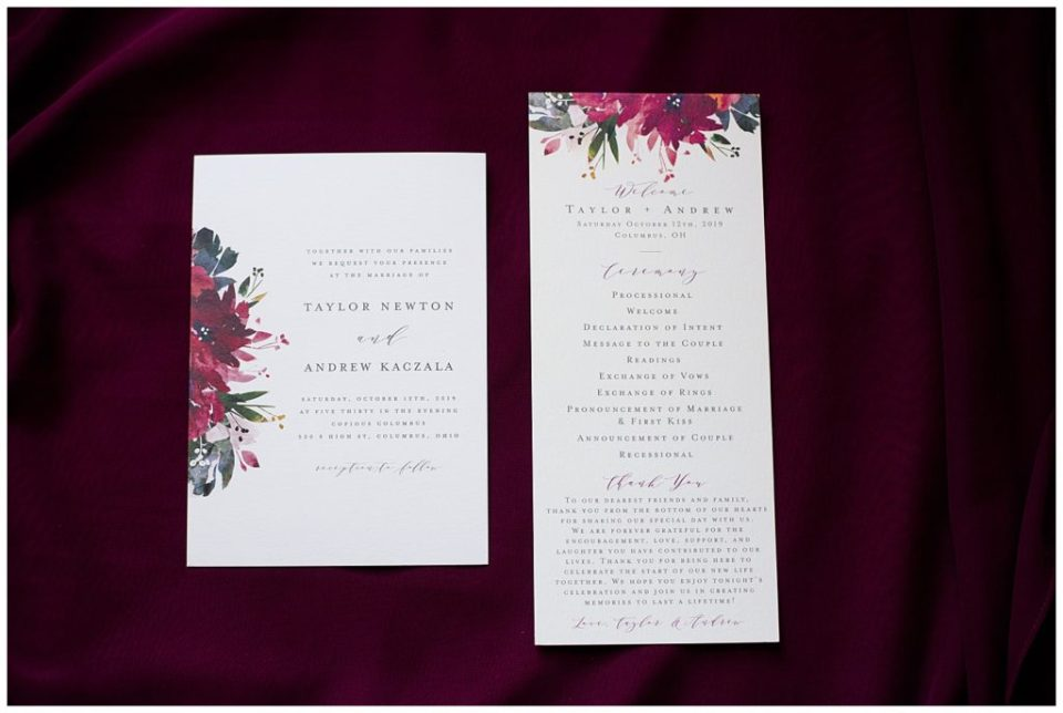 A photograph of a closeup of a wedding invitation and a program for the wedding ceremony by Columbus OH wedding photographer, Alayna Parker Photography