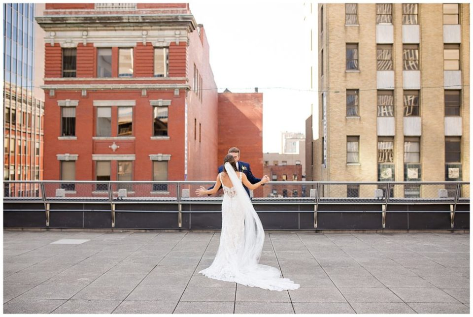 bride and groom on rooftop at renaissance hotel