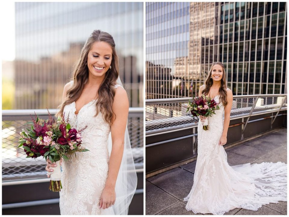 bride in lace sleeveless dress holding bouquet on rooftop at renaissance hotel
