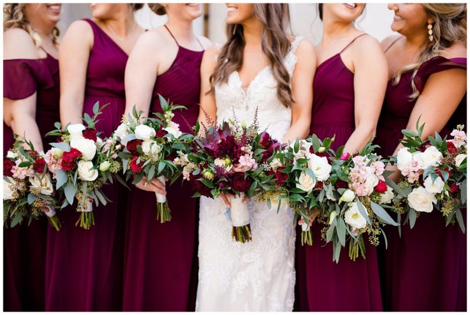 close up of bride and bridesmaids holding bouquets outside ohio statehouse
