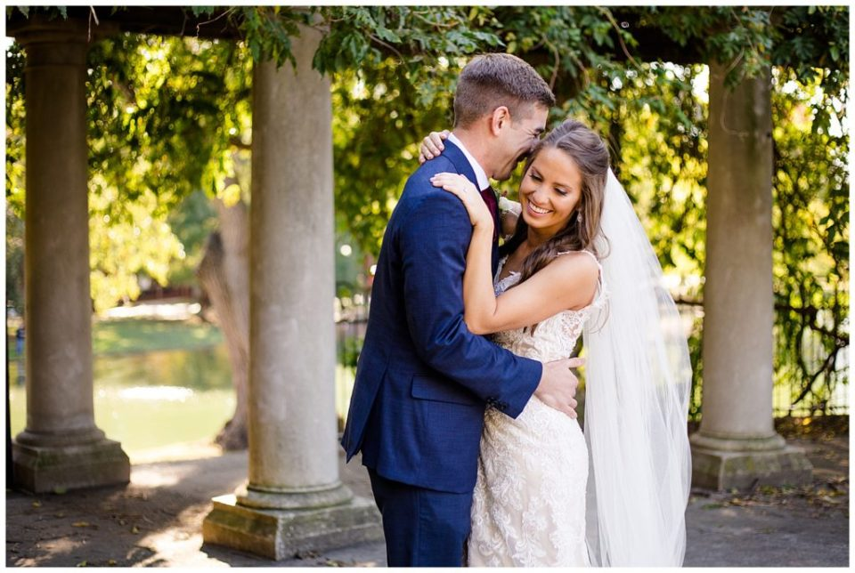 groom nuzzling into bride at schiller park in german village