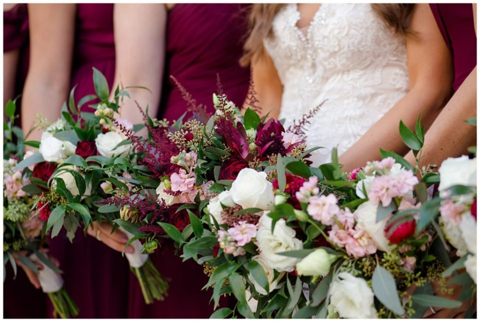 close up of bride and bridesmaids holding bouquets