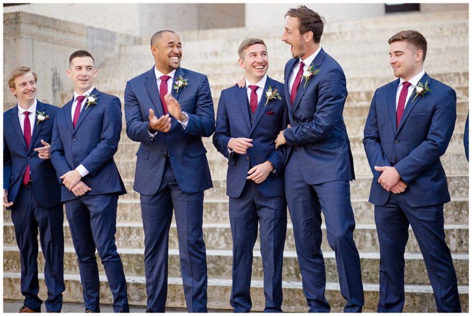 groom and groomsmen laughing and joking around at ohio statehouse