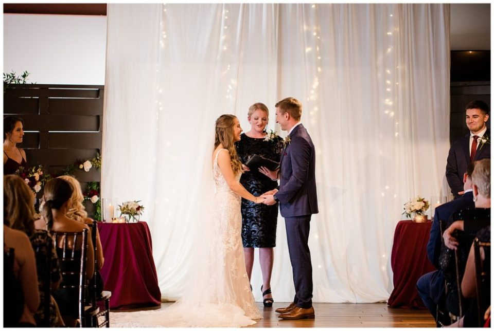 bride and groom laughing during ceremony at copius