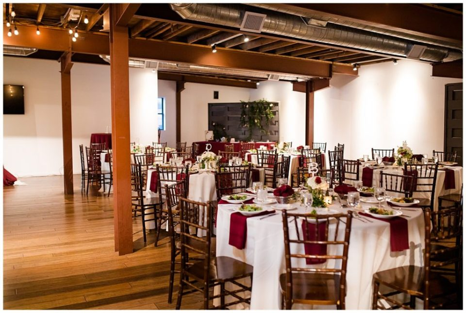 round tables set up for reception at copius