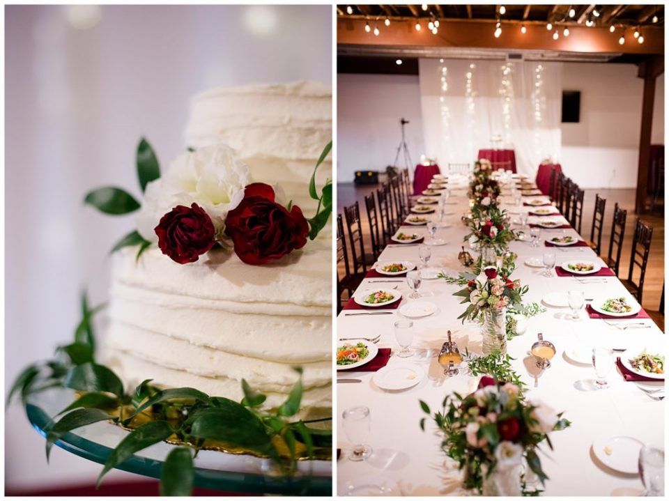 white wedding cake with burgundy and white flowers and greenery at copius
