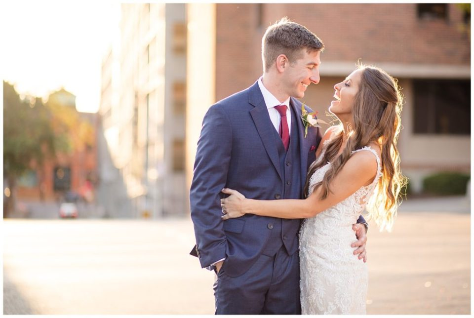 bride laughing at groom during golden hour in downtown columbus