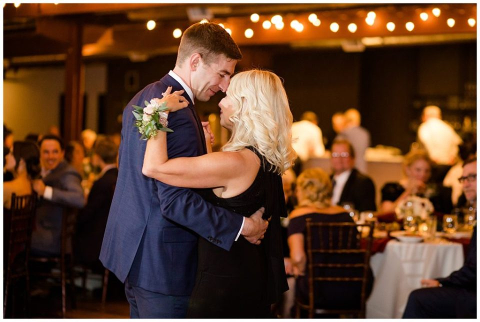 groom and mother dancing at copius