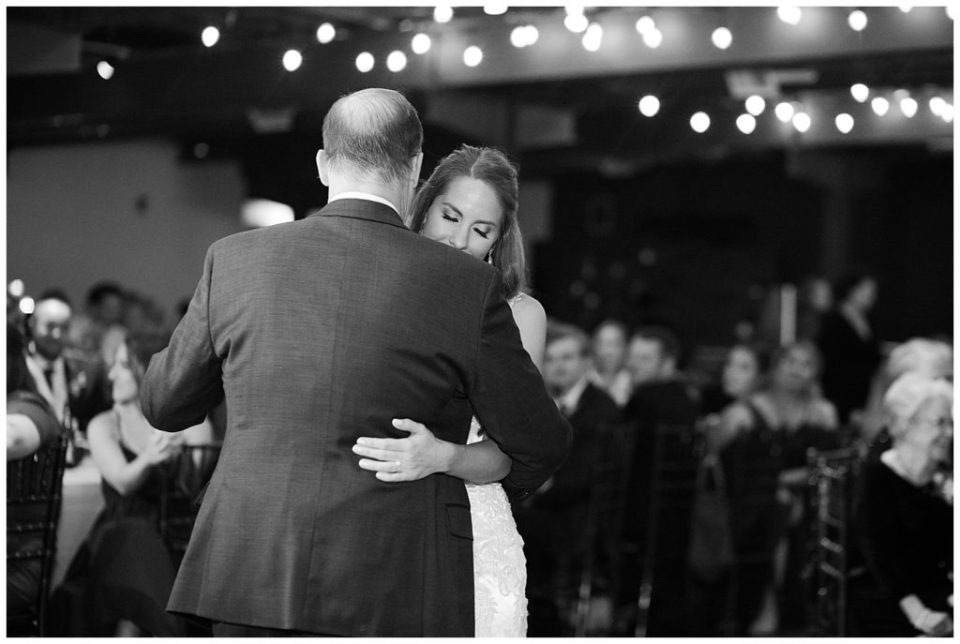black and white image of bride and father dancing at copius