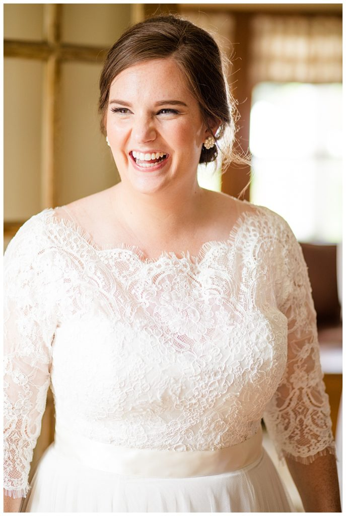 A picture of a closeup of a smiling bride in her wedding gown before the wedding ceremony at a Nationwide Conference Center wedding by Columbus  wedding photographer, Alayna Parker Photography