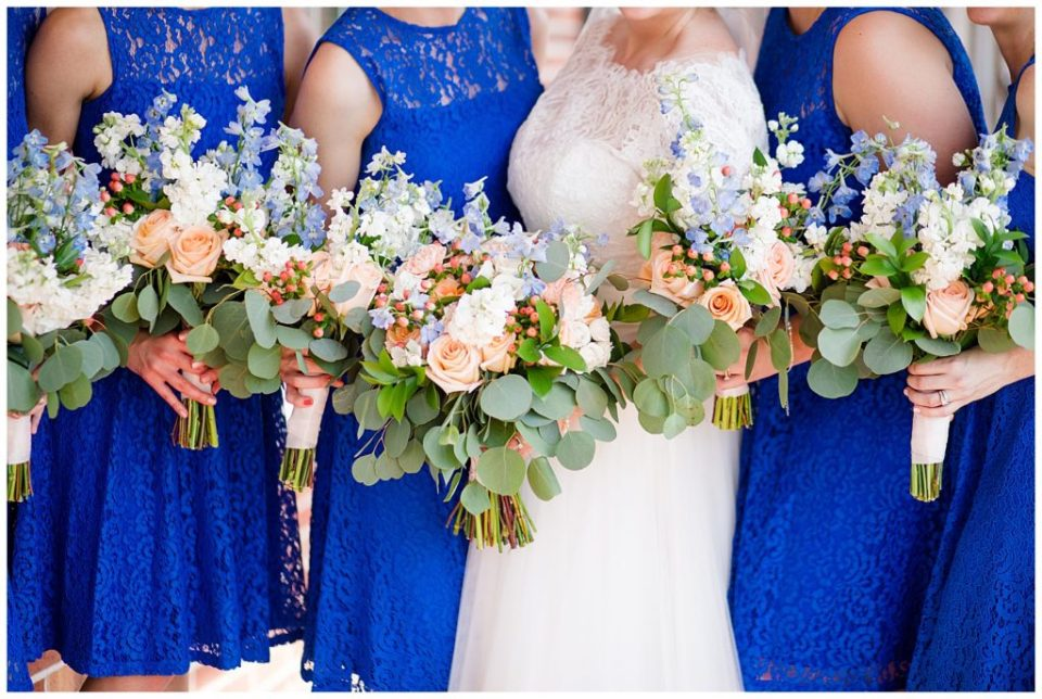A picture of the bride and bridesmaids holding their beautiful bouquets together at a Nationwide Hotel and Conference Center wedding by Columbus  wedding photographer, Alayna Parker Photography