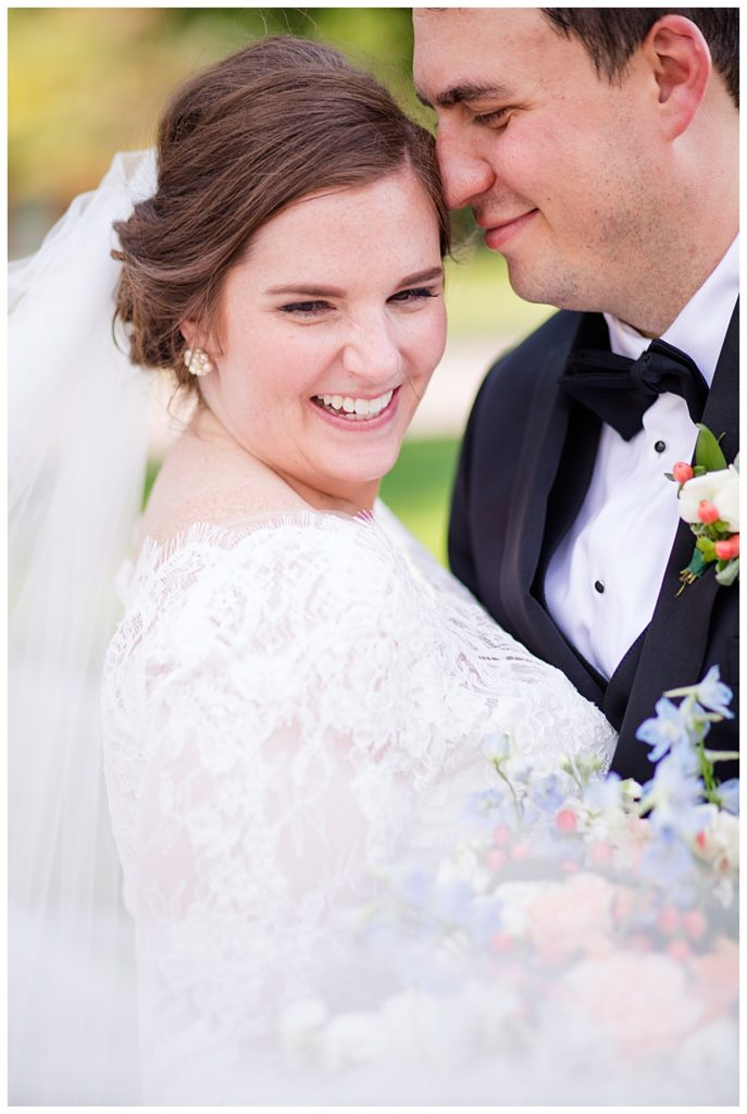An image of a closeup view of the smiling bride and groom romantically close together at a Nationwide Hotel and Conference Center wedding by Columbus Ohio wedding photographer, Alayna Parker Photography