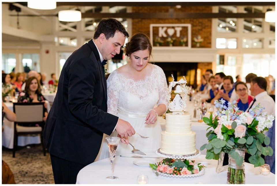 bride and groom cutting cake at nationwide hotel and conference center