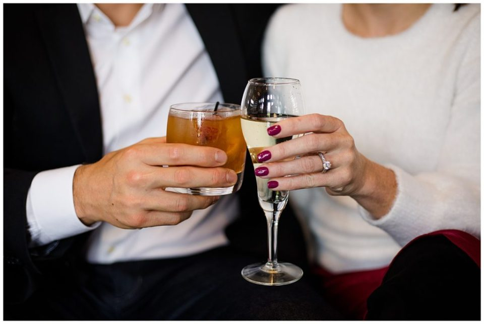 A picture of a closeup view of the engaged couple's hands holding their cocktail drinks, showing off the engagement ring at Brookside Golf & Country Club by Columbus  engagement photographer, Alayna Parker Photography