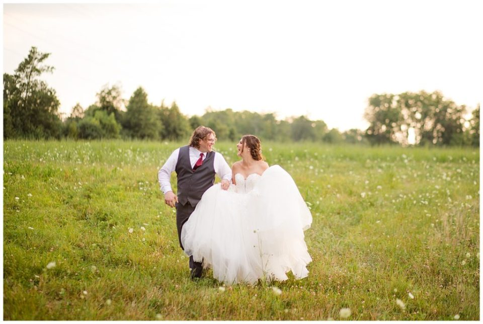 bride and groom during golden hour at brookside