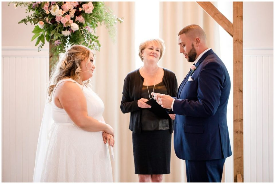 groom reading vows at the postmark