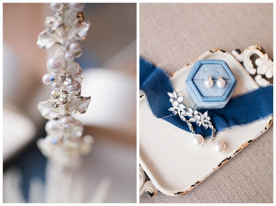 An image of a closeup view of the bride's jeweled hairband and a photo of her earrings resting on a blue ribbon draped across a small vintage tray by Alayna Parker Photography a Columbus Ohio wedding photographer