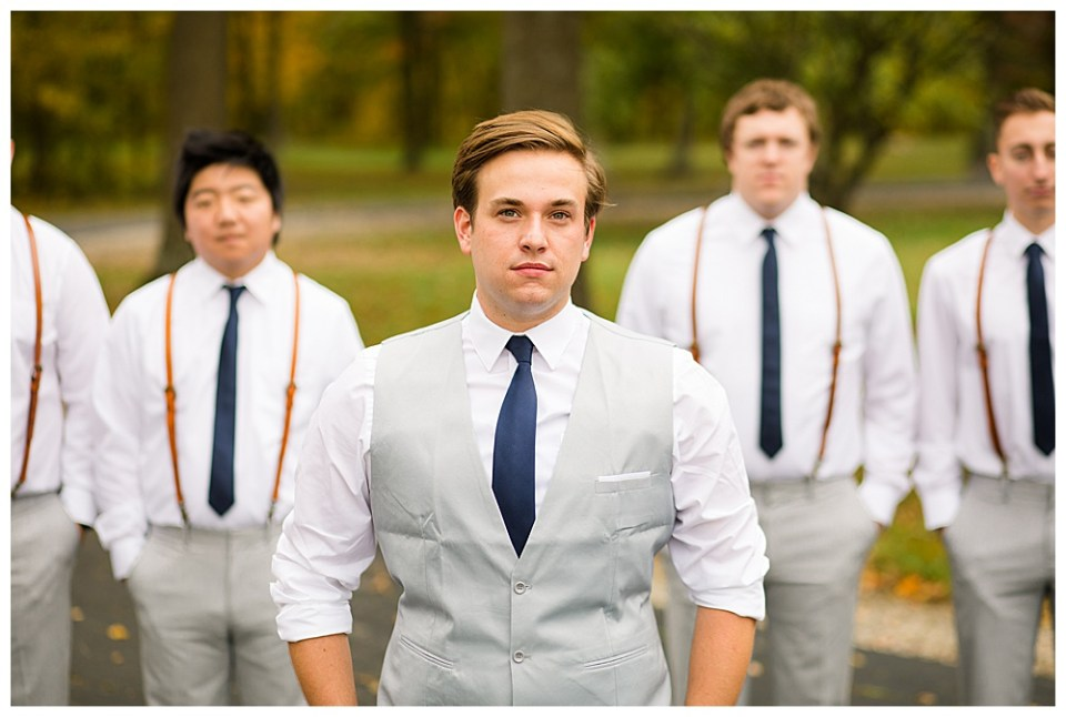 An image of the groom and his groomsmen closeup as they stand together in a quiet moment outside in their handsome wedding clothes at Dorral Farm in Marysville, OH