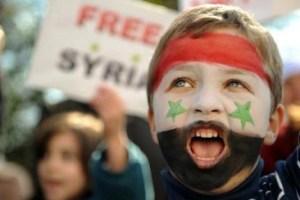 صورة أرشيفية لطفل يشارك في إحدى مظاهرات سوريا