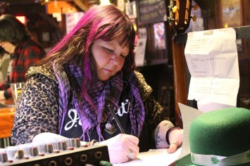 Kim Dreizehn writing at the bar at Brass Tacks, March 19, 2019