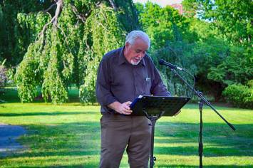"""Poet reading """"Song of Myself""""in Washington Park in Albany, NY on May 31, 2016"""