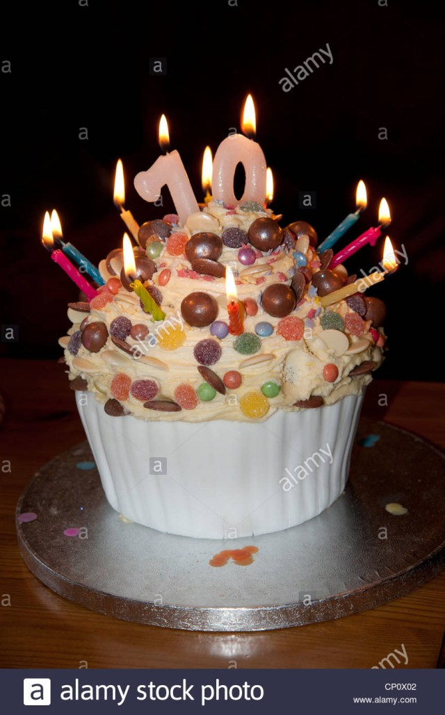 70Th Birthday Cake 70th Birthday Cake With Lighted Candles And Decorated With Sweets