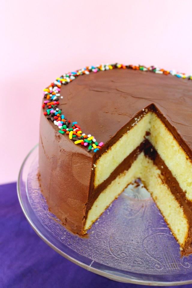 Birthday Cake Frosting Yellow Birthday Cake With Fluffy Chocolate Ganache Frosting
