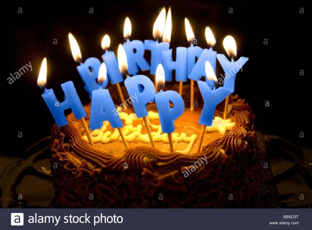 Birthday Cake Images With Candles A Birthday Cake With Lighted Letter Candles Spelling Happy Birthday