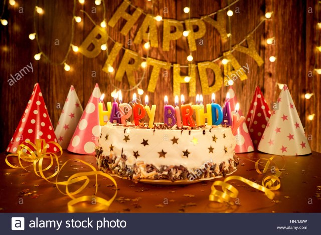 Birthday Cakes With Candles Happy Birthday Cake With Candles On The Background Of Garlands A