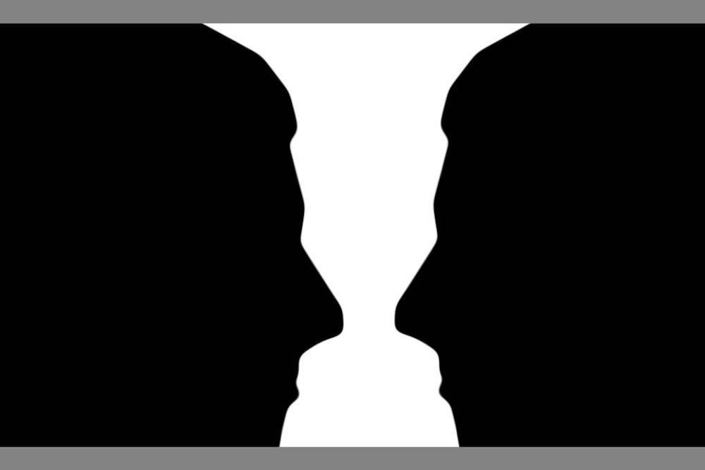 illusione ottica vaso o volti che si fissano