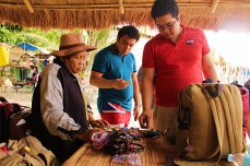 Manang sells souvenirs to tourists as we wait.