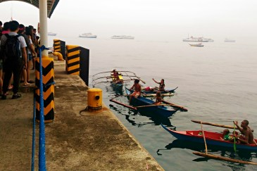 """These boat dwellers were shouting """"hagis"""", asking the tourists to give them coins."""