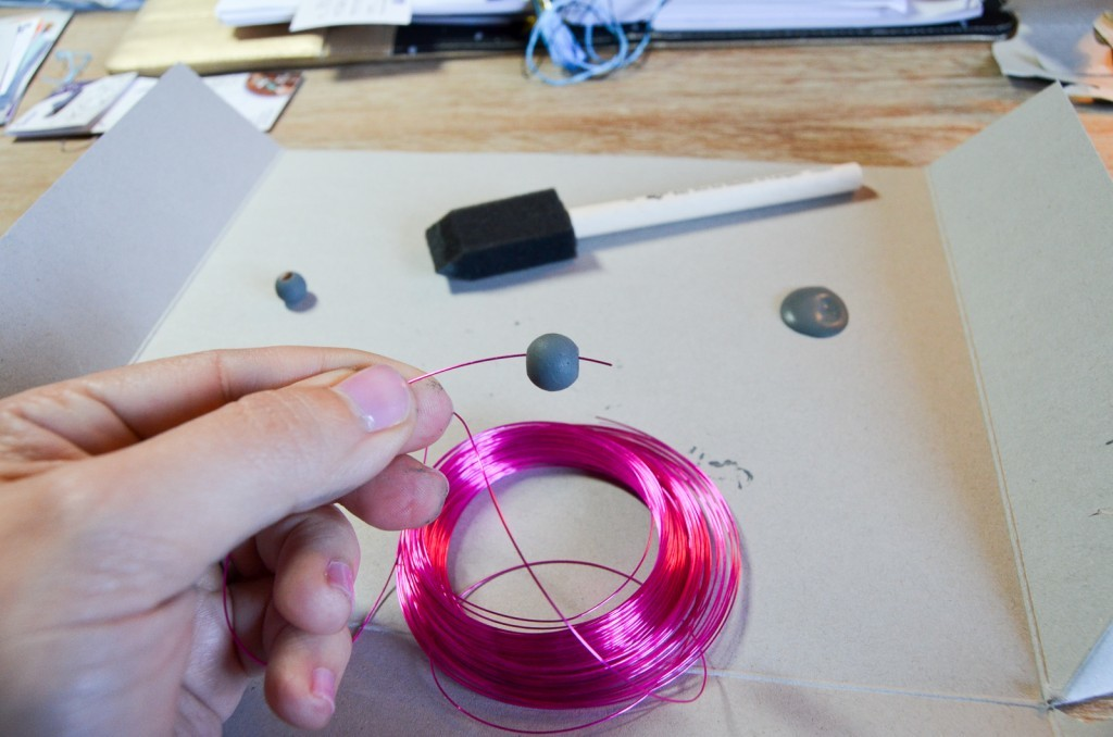 poke the wire through the bead