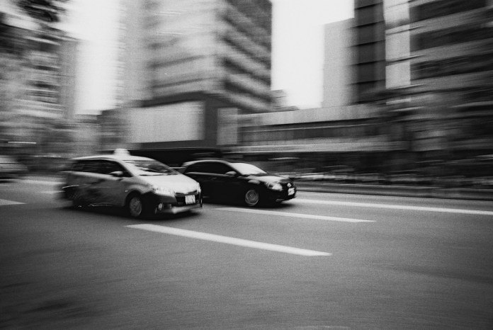 Street racers - Ilford FP4+ shot at EI 800. Black and white negative film in 35mm format. Push processed 2+2/3 stops.