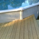 Decking cut to contour of pool