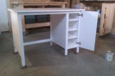 Desk with concealed adjustable shelving
