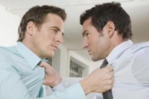 Germany, Munich, two Business men fighting in office, close-up