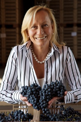 "Marilisa Allegrini with Corvina grapes in the grape drying center called ""Terre de Fumane"". These grapes are used in Amarone wines. Allegrini grapes are dried in this facility."
