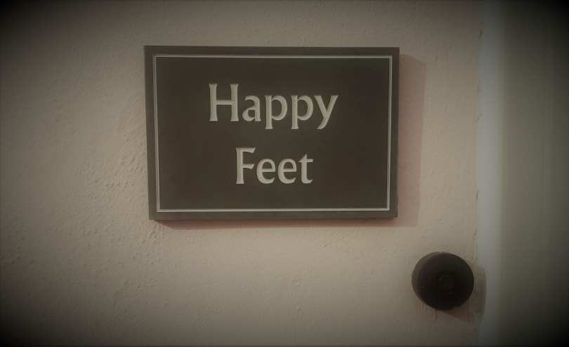 Sign saying Happy feet to show taht the barefoot sub will never outrun the joy of running.