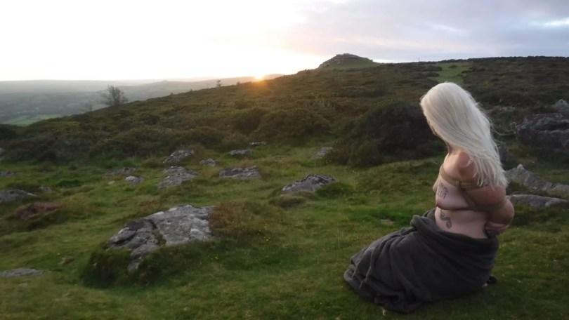 Practising self care, in rope, under a blanket on dartmoor
