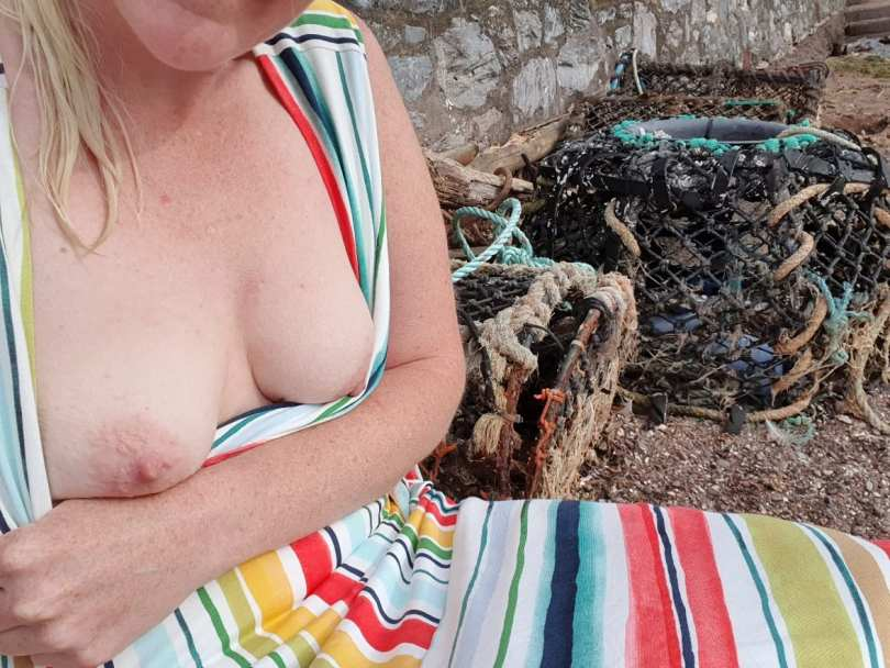 Topless beside the lobster pots and fishing nets