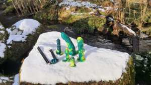 Family day out, group photo by the icy stream