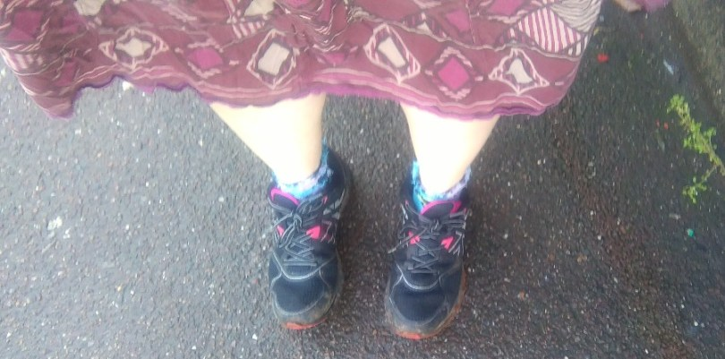 In a skirt with bare legs and running shoes the barefoot sub has been tasked to perfection.