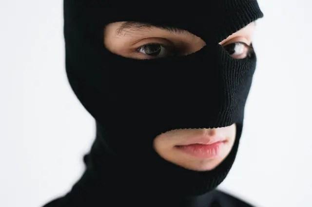 sneaky man in balaclava for exposing bad behaviour