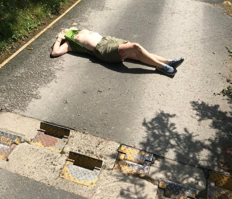 Bump in the road header image shows a lady laying between speed bumps, exposing her breasts.