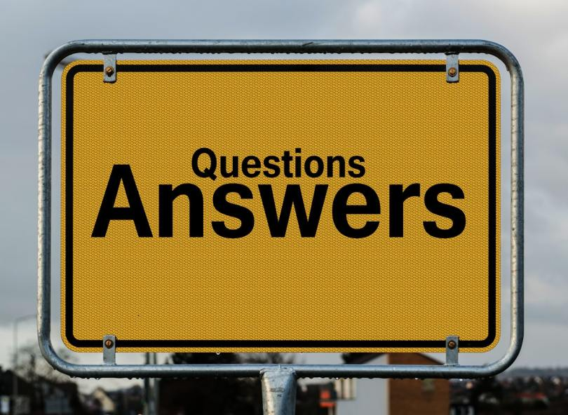 Passionately Curious header image shows a yellow sign road with the words Questions Answers on.
