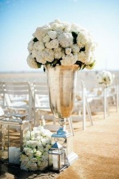 wedding-trends-2019-tall-elegant-silver-vase-and-lanterns-with-white-flowers-decorated-the-aisle-yvette-roman-photography