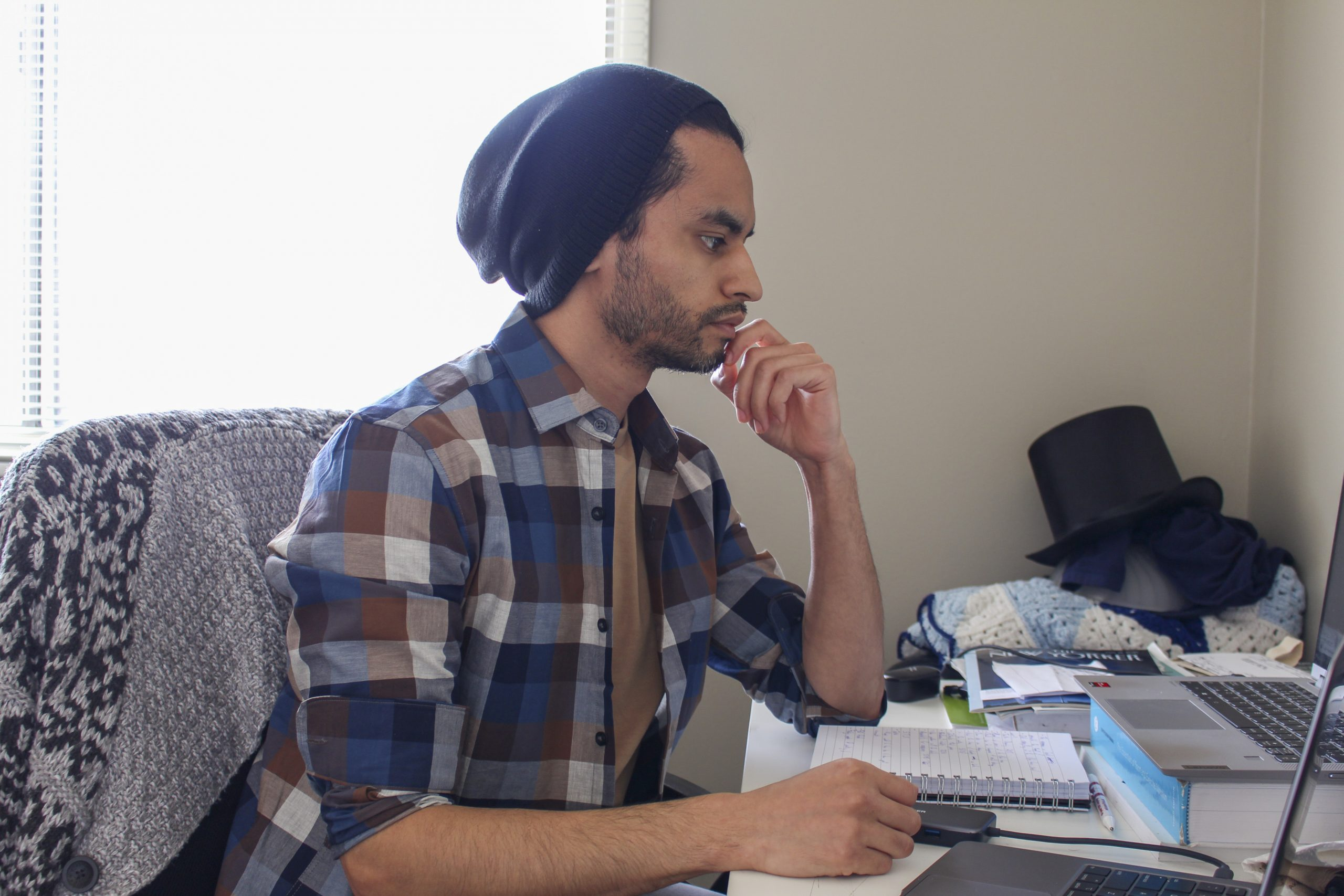 Alejandro Melgar sits in front of his laptop in his apartment in Calgary on April 2, 2021. Melgar is a journalism student at SAIT, and at 32, has been attending online school as a result of the COVID-19 pandemic. (Photo by Alejandro Melgar/SAIT)