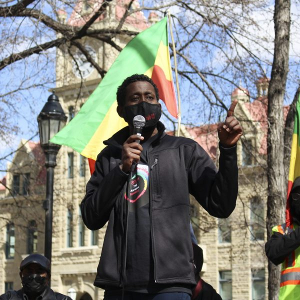 Elias Haile speaks in Amharic to a group of protestors in Olympic Plaza in downtown Calgary on April 11, 2021. Haile is regularly active within the Amhara community, and he speaks out against the genocide of the Amhara people in Ethiopia. According to the Ethiopian Human Rights Council (EHRCO), there have been 1100 deaths due to the massacre from November 2020 till April 2021. (Photo by Alejandro Melgar/SAIT)
